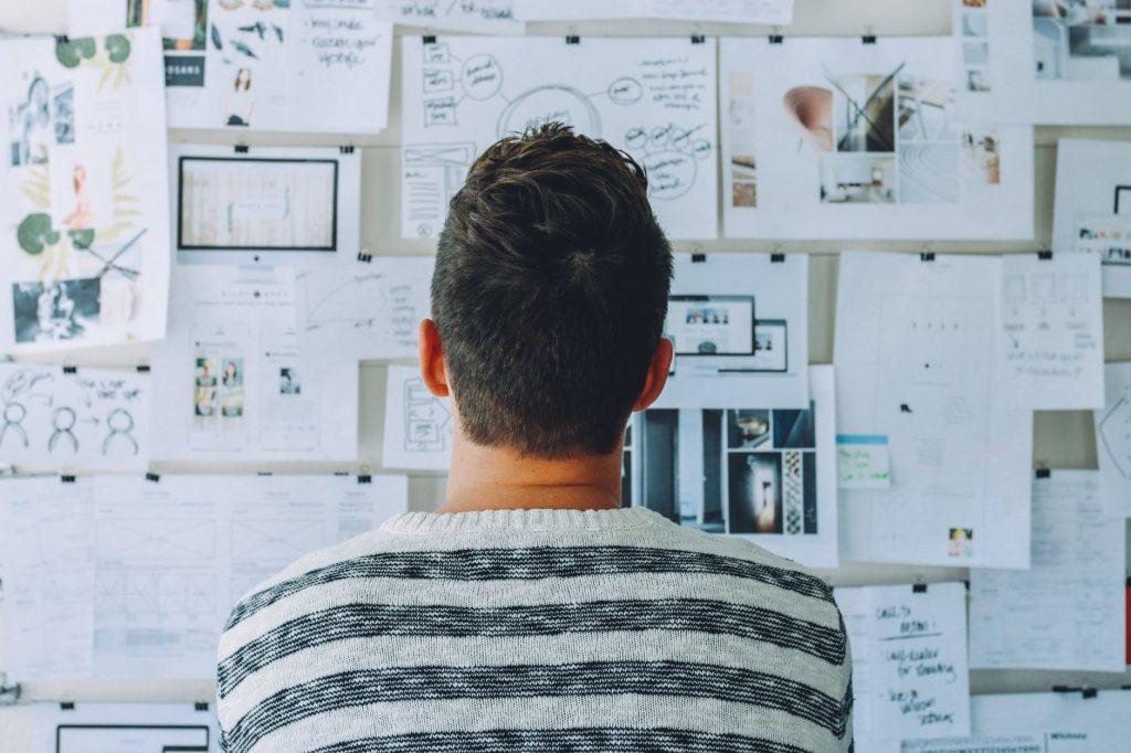 Man looking at a bulletin board